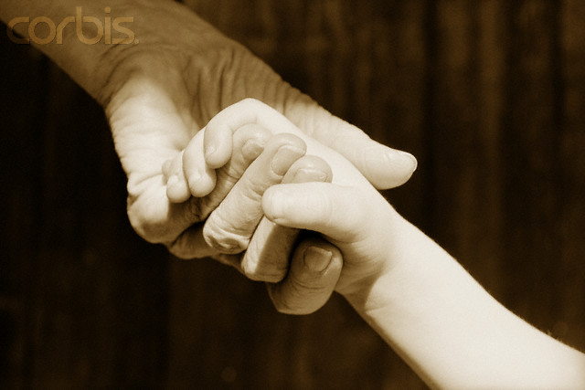 Grandfather and Grandson Holding Hands --- Image by © Claudia Kunin/CORBIS
